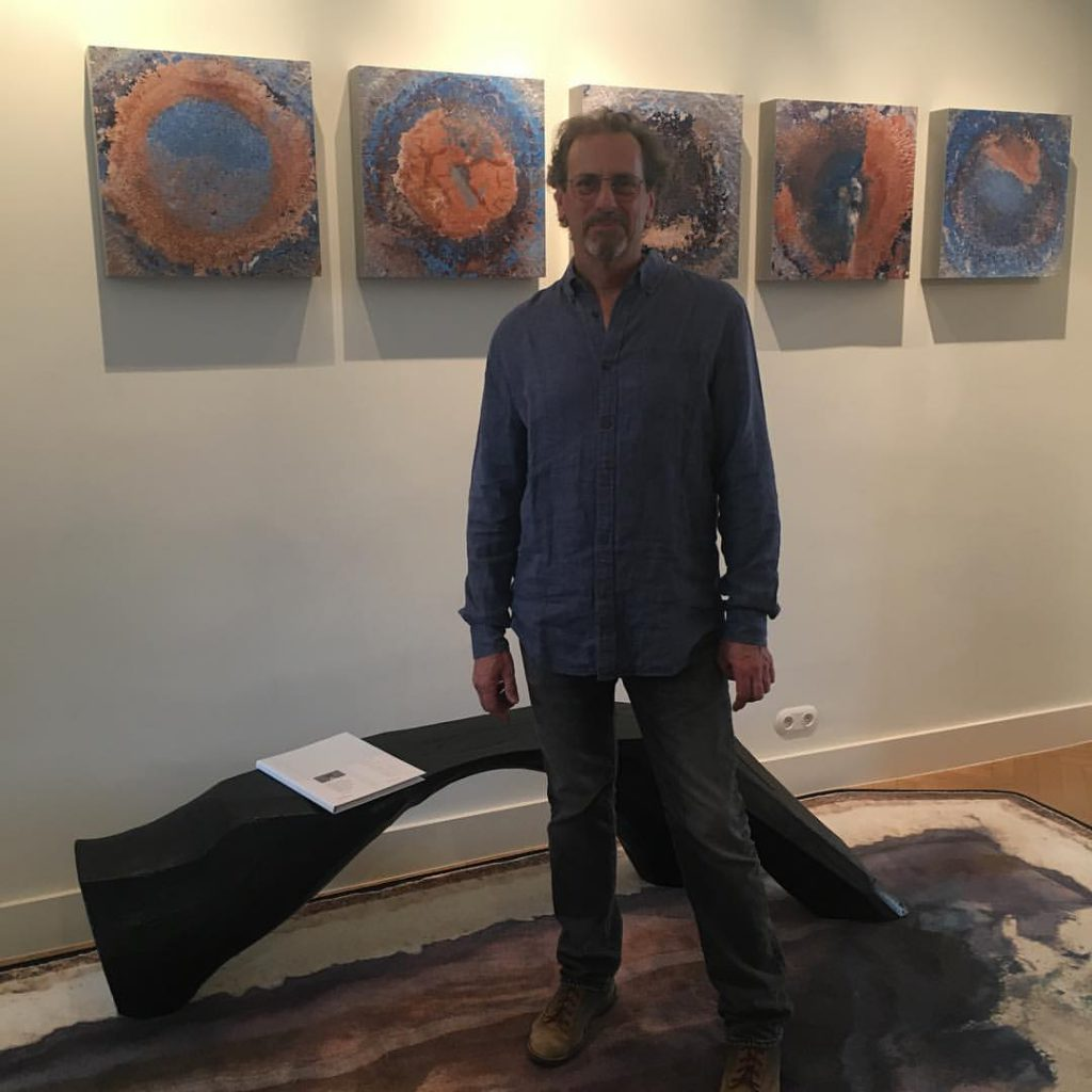 Welcome to Tom Joyce in front of his Well series I-V, dyed infused photographs on aluminum.